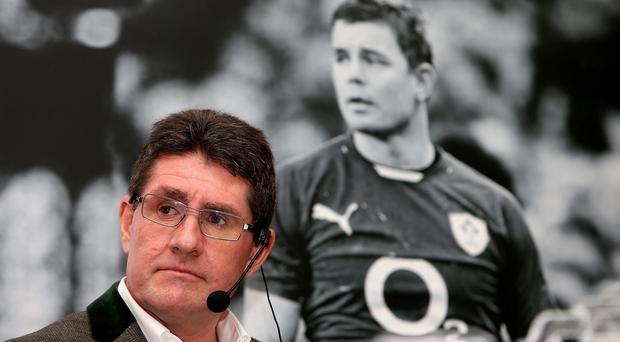 Paul Kimmage in front of a picture of Brian O'Driscoll