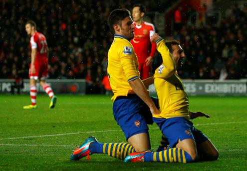 Arsenal's Santi Cazorla celebrates his goal with teammate Olivier Giroud after scoring against Southampton during their English Premier League soccer match at St.Mary's Stadium