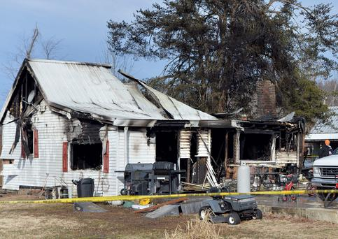 Eleven people lived in the home in the Depoy community of Muhlenberg County, Greenville