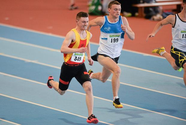 Keith Doherty, left, on his way to winning the Junior Men's 60m