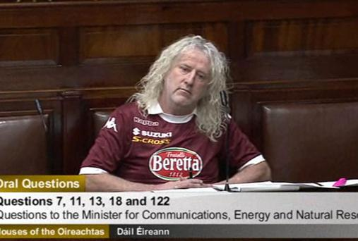 Mick Wallace wearing football jersey in Dail