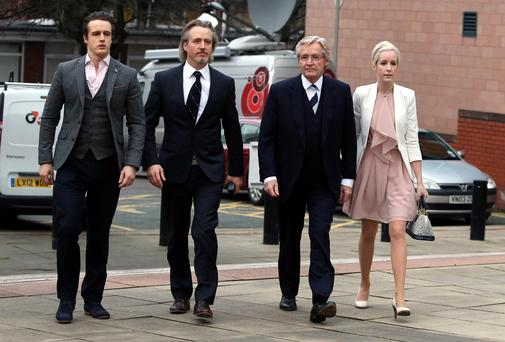 Coronation Street actor Bill Roache (second right) arrives at Preston Crown Court with his sons, James (far left), Linus and daughter Verity. PA