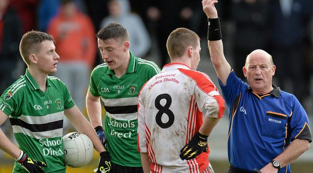 Pobalscoil Chorca Dhuibhne captain Barra Ó Súilleabháin is shown a black card by referee Kevin Walsh