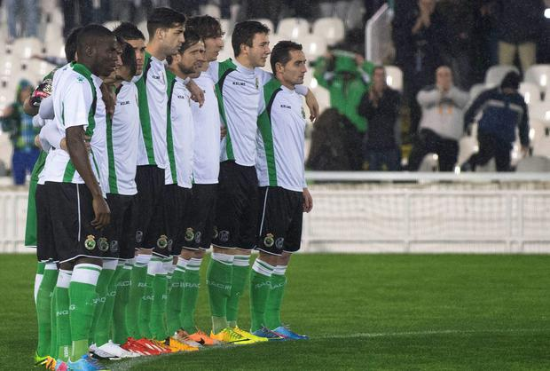 Racing Santander players stand in a line and refuse to play as a protest over unpaid wages