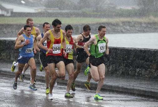 The leaders brave the elements in the John Treacy Dungarvan 10-mile race. Photo: Garry Lee