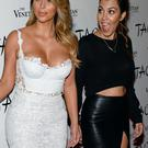elevision personalities Kim Kardashian (L) and Kourtney Kardashian
