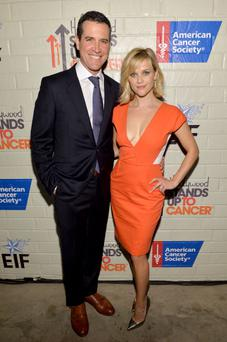 Co-Hosts Reese Witherspoon (R) and Jim Toth attend Hollywood Stands Up To Cancer Event with contributors American Cancer Society and Bristol Myers Squibb hosted by Jim Toth and Reese Witherspoon and the Entertainment Industry Foundation on Tuesday, January 28, 2014 in Culver City, California. (Photo by Michael Buckner/Getty Images for Entertainment Industry Foundation)