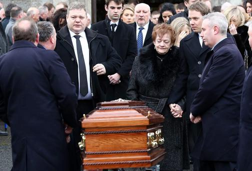 Jim Mansfield's sons, Tony, left, PJ right and widow, Anne pictured at his funeral