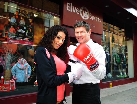 Irish Super Middleweight champion Jim Rock with model Georgia Salpa at the official opening of Elverys Sports in the heart of Dun Laoghaire in 2007