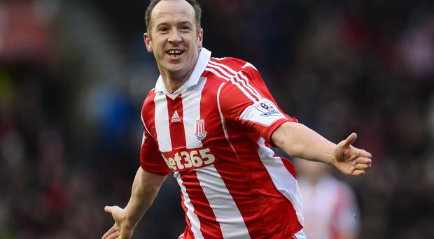 Charlie Adam of Stoke City celebrates scoring the opening goal during the Barclays Premier League match between Stoke City and Manchester United at Britannia Stadium
