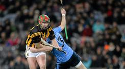 Eoin Larkin, Kilkenny, is tackled by Peter Kelly, Dublin