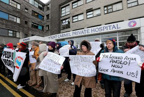 Protestors gather outside Mount Carmel Private Hospital