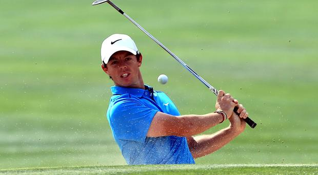 Rory McIlroy hits a bunker shot on the 6th hole during the third round of the Dubai Desert Classic