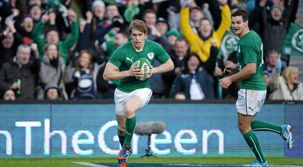 Ireland's Andrew Trimble runs in to score his side's first try of the game. Photo: Brendan Moran / SPORTSFILE