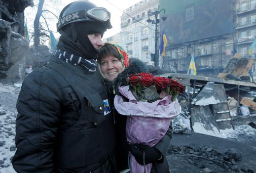 An opposition supporter hugs his future bride after he asked her to marry him at barricades in central Kiev, the epicentre of Ukraine unrest