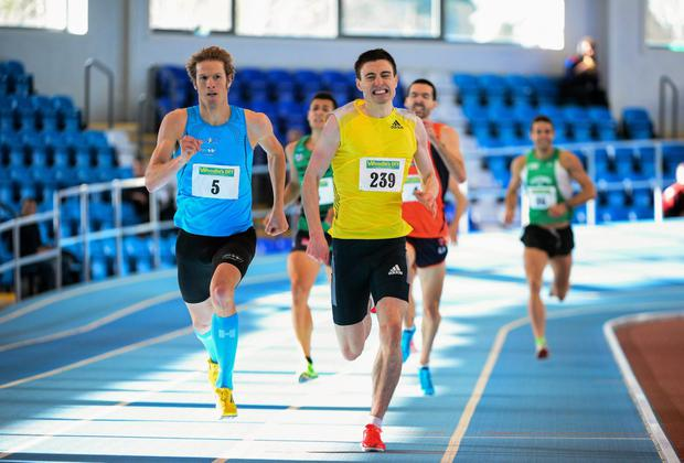 Mark English, UCD AC, 239, sets a new Irish indoor record of 1:46.82s as he crosses the finish line in second place behind Thijem Cupers, Holland