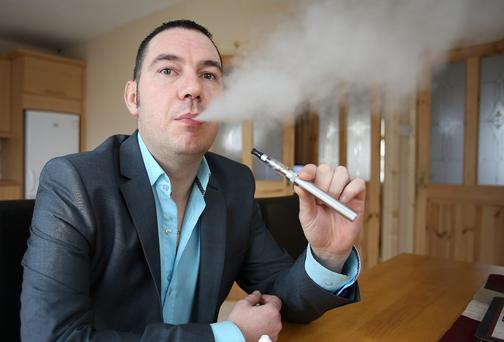 Keith Buckley with an e-cigarette, at his home in Clondalkin. Picture: Frank McGrath