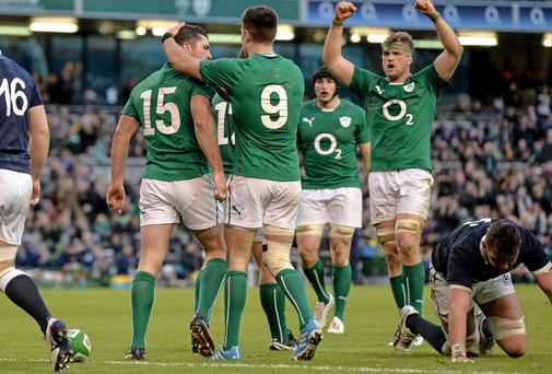 Rob Kearney is congratulated by team-mates including Jamie Heaslip after scoring Ireland's third try against Scotland. Picture: Paul Mohan / SPORTSFILE