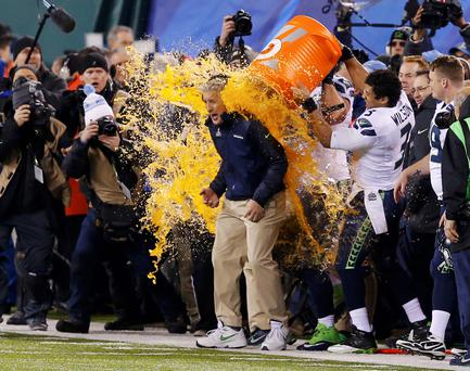 Seattle Seahawks head coach Pete Carroll gets gatorade dumped on him in celebration near the end of the fourth quarter against the Denver Broncos during the NFL Super Bowl XLVIII football game in East Rutherford, New Jersey, February 2, 2014. REUTERS/Eduardo Munoz (UNITED STATES - Tags: SPORT FOOTBALL TPX IMAGES OF THE DAY)