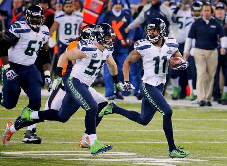 Seattle Seahawks wide receiver Percy Harvin (11) returns a kickoff for a touchdown against the Denver Broncos
