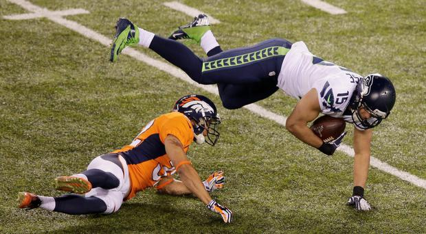 Denver Broncos' Tony Carter hits Seattle Seahawks' Jermaine Kearse during the second half of the NFL Super Bowl XLVIII football game Sunday.