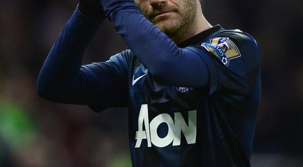 Juan Mata walks off the pitch after United's defeat to Stoke