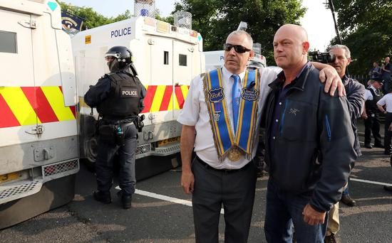 Previously unreleased picture dated 12/07/13 of Ross Kemp (right) photographed with a Orangeman during filming of his television documentary Extreme World during sectarian riots in north Belfast.