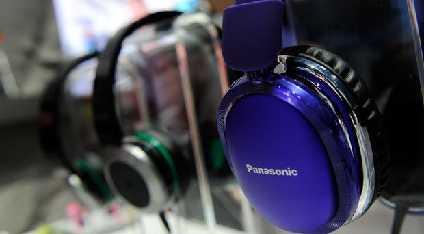 Noise canceling headphones are on display at the Panasonic booth at the 2014 International CES at the Las Vegas Convention Center