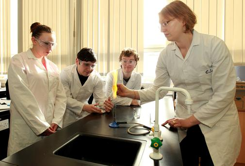 Firing up the youth: Cavan Institute students Catherine O'Reilly, David Beatty and Alexander Cliffe with science tutor Nora Hennessy.