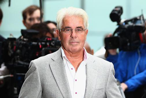 Max Clifford speaks to the press after leaving Southwark Crown court on October 4, 2013 in London
