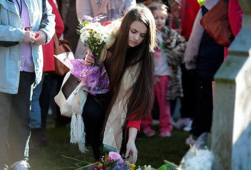 A young woman lays flowers at the Justice for Magdalenes second annual Flowers for Magdalenes event at Glasnevin cemetery, Dublin. Picture: Arthur Carron/Collins