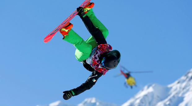 Seamus O'Connor of Ireland performs a jump during slopestyle snowboard training at the 2014 Sochi Winter Olympics