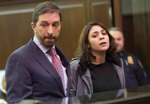 Juliana Luchkiw (R) is pictured in court with defense attorney Stephen Turano during her arraignment in New York February 5, 2014.