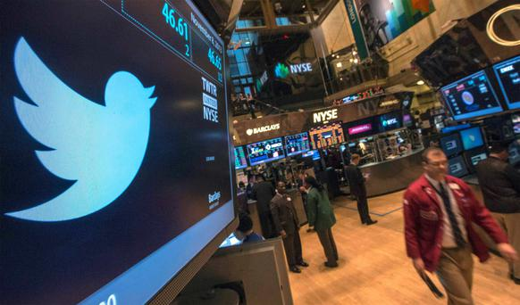 The Twitter logo is displayed on the floor of the New York Stock Exchange. Reuters