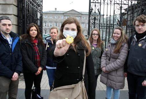 TCD student nurse Alison Sothern takes part in the Dail protest