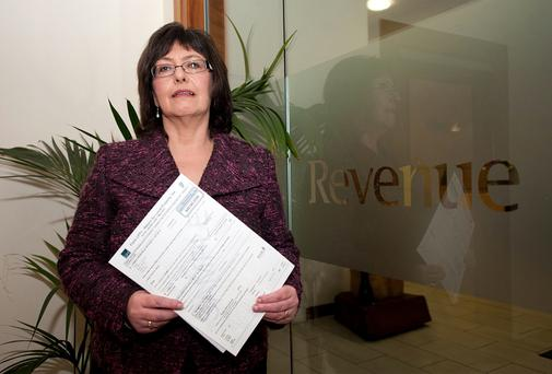 Revenue chairwoman Josephine Feehily with the local property tax form