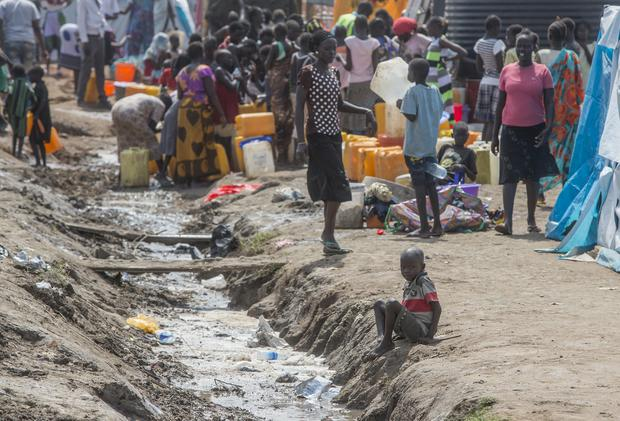 A boy sits at the edge of open sewer at the UN base in Juba, South Sudan. Picture: Mark Condren