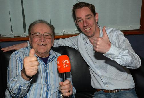 Ryan Tubridy, right, revealed on his 2FM morning show that Larry Gogan, left, is leaving his 'Golden Hour' weekday show on the station and moving to a new weekend slot