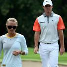 Caroline Wozniacki of Denmark follows her fiancee Rory McIlroy of Northern Ireland during the final round of the 2014 Omega Dubai Desert Classic on the Majlis Course at the Emirates Golf Club on February 2, 2014 in Dubai, United Arab Emirates. (Photo by Warren Little/Getty Images)