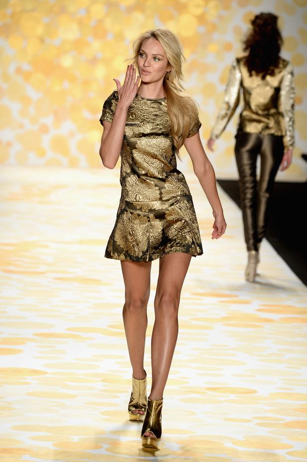 Model Candice Swanepoel walks the runway at Desigual fashion show during Mercedes-Benz Fashion Week Fall 2014 at The Theatre at Lincoln Center