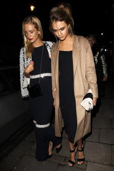 LONDON, ENGLAND - FEBRUARY 07: Poppy Delevingne and Cara Delevingne leaving a Wedding Lunch for her sister Chloe at Mark's Clubon February 7, 2014 in London, England. (Photo by Neil P. Mockford/FilmMagic)