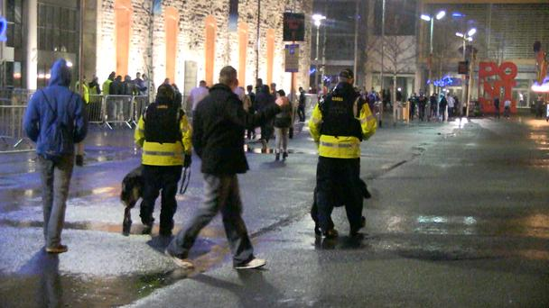 Gardai walk with sniffer dogs while Hardwell fans filter into the venue. Photo: Jason Kennedy