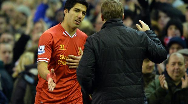 Liverpool striker Luis Suarez and manager Brendan Rodgers have put the summer transfer saga behind them