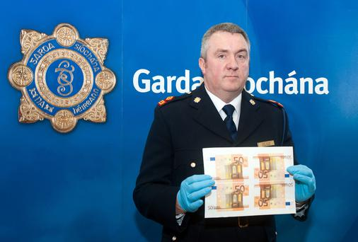 Superintendent David Taylor shows off counterfeit notes at Garda HQ, Phoenix Park.