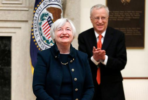New Federal Reserve Board chairwoman Janet Yellen smiles as her husband George Akerlof applauds her after she took the oath of office. She will deliver the semi-annual monetary policy report on Tuesday.