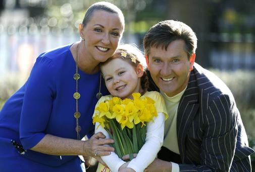 Majella and Daniel O'Donnell pose with Ruby Mason at the launch of the Irish Cancer Society's 27th Daffodil Day yesterday. The charity hopes to raise €3.45m during this year's campaign. Picture: Andres Poveda