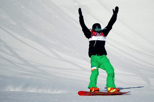 Ireland's Seamus O'Connor raises his arms as he reaches the finish line during the men's snowboard slopestyle semi-final