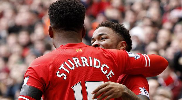 Liverpool's Raheem Sterling celebrates scoring his teams fifth goal of the game with teammate Daniel Sturridge (left) during the Barclays Premier League match at Anfield