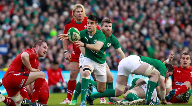 Ireland's Conor Murray (C) clears the ball against Wales in their Six Nations rugby union match at Aviva stadium