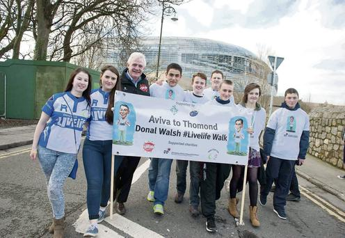 Fionnbar Walsh father of the late Donal Walsh who lost his battle to cancer in May 2013 with Tralee transition year students and CBS The Green Tralee and Tralee RFC starting the walk from the Aviva to Thomond Park in Munster to raise funds for the Donal Walsh #Livelife Foundation, CMRF Our Ladys Hospital, Crumlin and Tralee RFC Charities. Photo: El Keegan